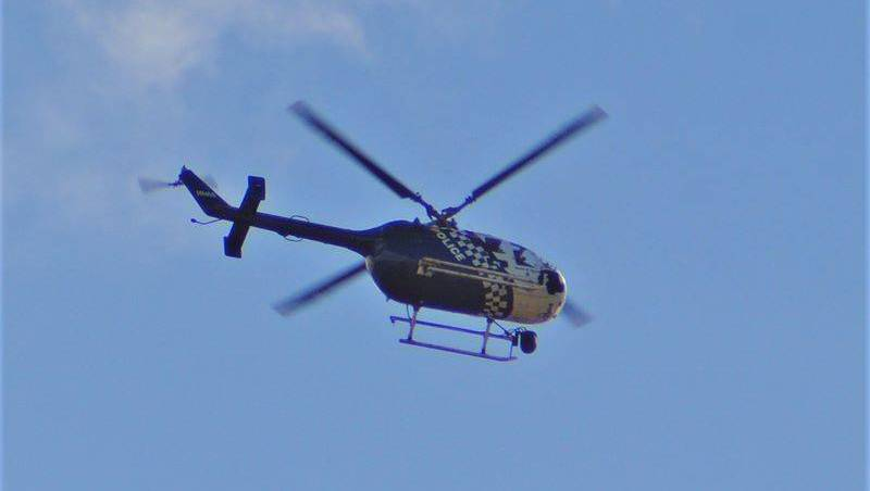 CHOPPER: A police helicopter over Wellington Point last week. Photo: Malakai Keen