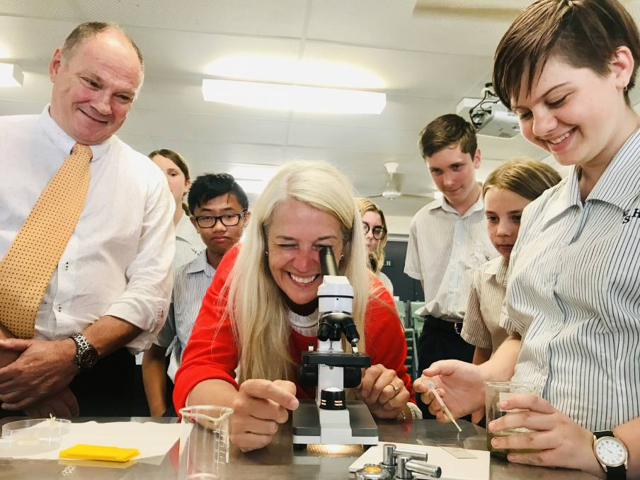 UNDER THE MICROSCOPE: Redland MP Kim Richards at the Victoria Point State High School science lab with principal Scot Steinhardt and some of the students.