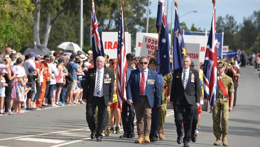TRIBUTE: Veterans, RSL members march in the Anzac Day parade and ceremony at Cleveland in 2019.