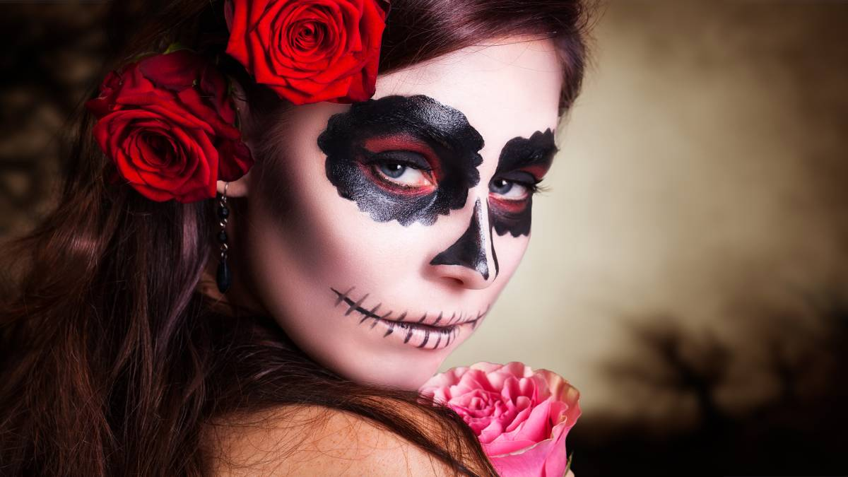 All you need for a sugar skull costume is some face paint and some flowers. Picture: Shutterstock